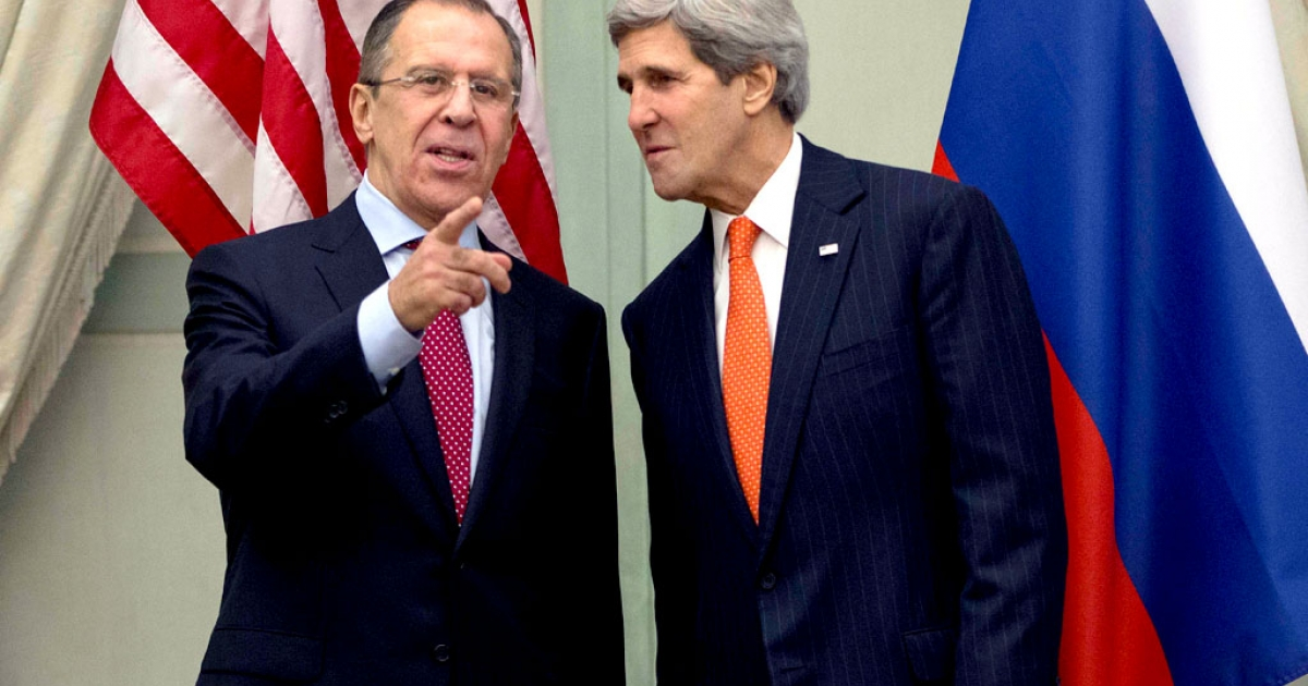 US Secretary of State John Kerry (R) talks with Russia's Foreign Minister Sergei Lavrov before the start of their meeting at the U.S. Ambassador's residence in Paris, on January 13, 2014.</p>