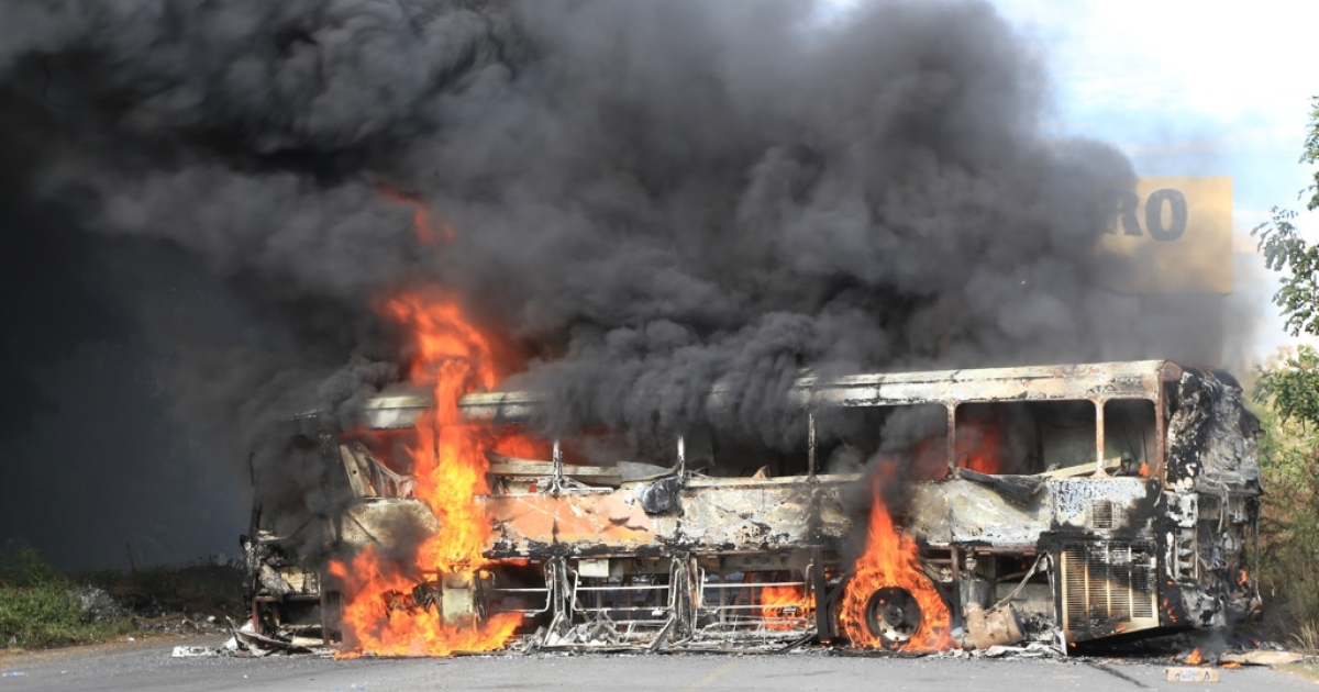 A burning bus in Paracuaro, in Mexico's western Michoacan state, was one of the stark signs of anger against the so-called self-defense militias.</p>