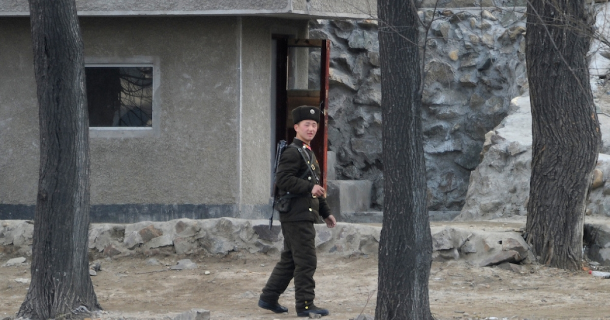 A North Korean soldier patrols along the Yalu River at the North Korean town of Sinuiju on April 11, 2013. To enter the country as a Westerner, you typically need to bring something of value to the regime, like tourist cash or propaganda value. Tuberculosis experts are also welcome.</p>
