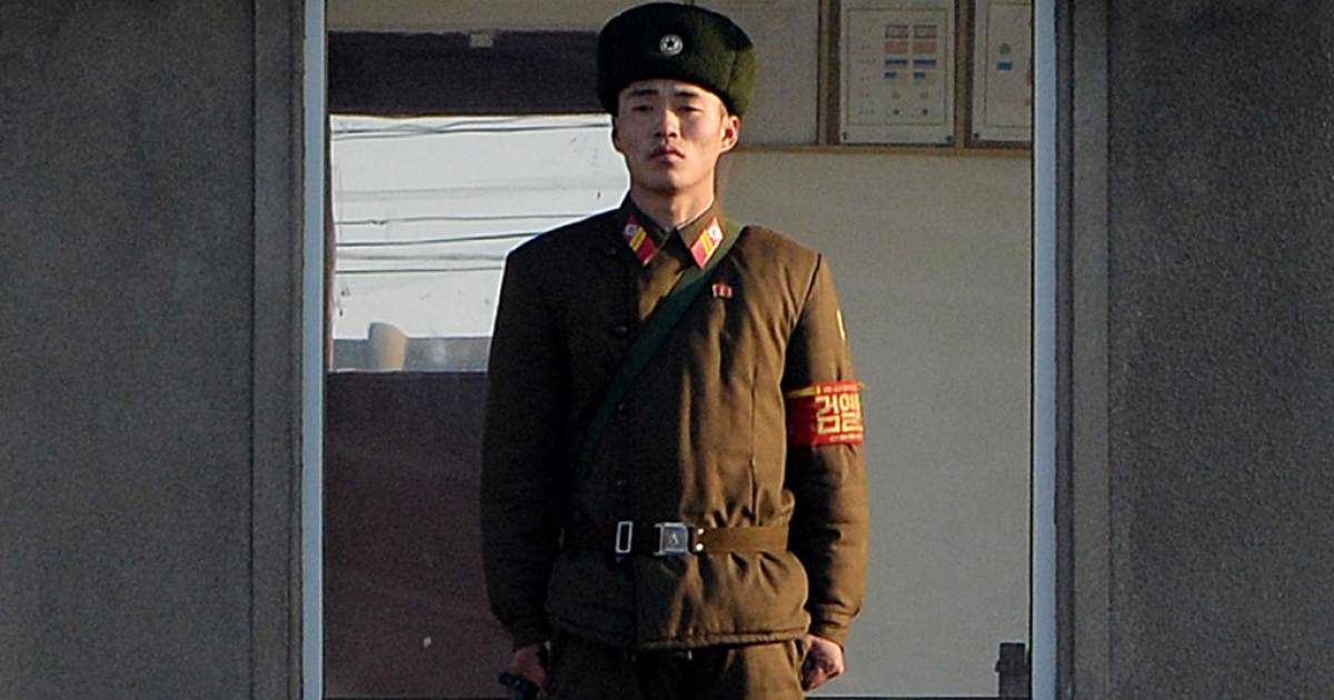A North Korea soldier stands guard on the banks of the Yalu River which separates the North Korean town of Sinuiju from the Chinese border town of Dandong, Dec. 17, 2013.</p>