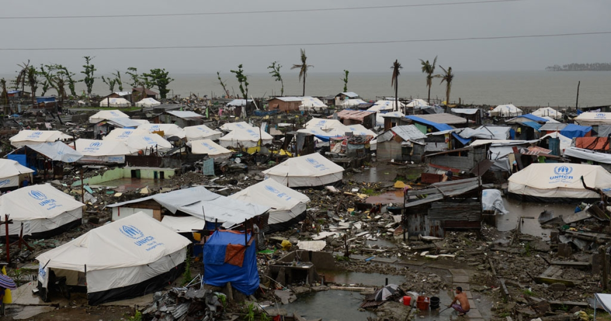 Tents are erected as temporary shelters for residents whose houses were flattened by super Typhoon Haiyan in Tacloban, Leyte, Philippines on December 25, 2013.</p>