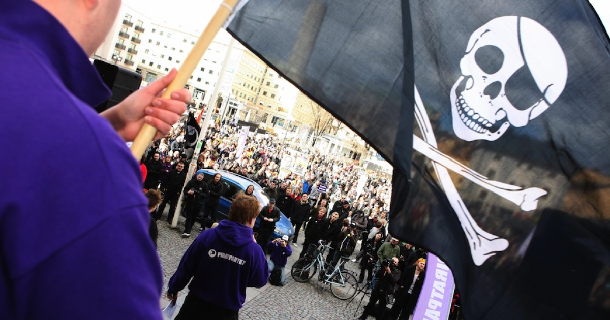 Supporters of the The Pirate Bay website demonstrate in Stockholm, on April 18, 2009.</p>