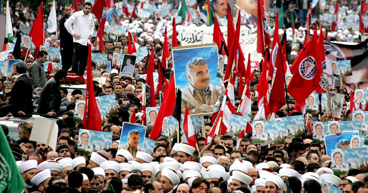People gather in downtown Beirut for the funeral of Lebanon's slain former prime minister Rafik Hariri on February 16, 2005.</p>
