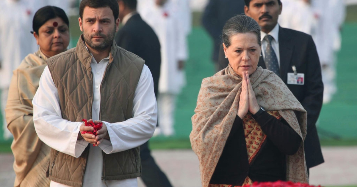 Chairperson of India's Congress-led UPA government, Sonia Gandhi (R) with her son, Congress Party Vice President, Rahul Gandhi (L) in New Delhi on November 14, 2013.</p>