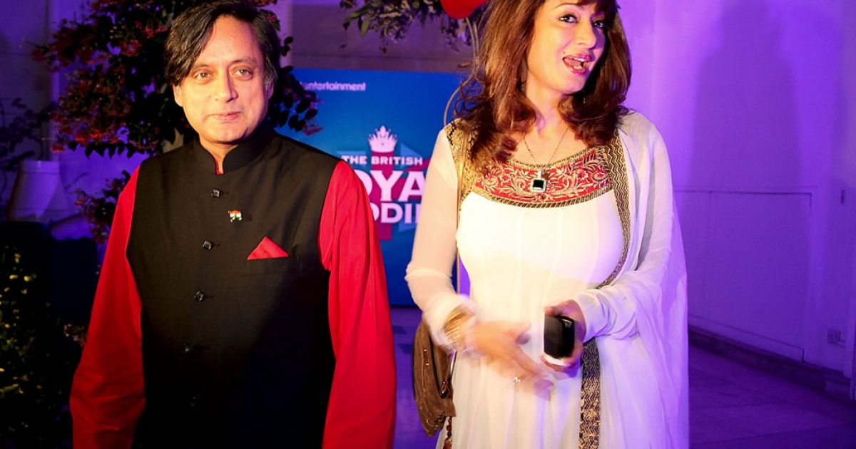 Shashi Tharoor and his wife Sunanda Pushkar arrive at the British High Commissioner's residence on April 29, 2011 in Delhi, India.</p>