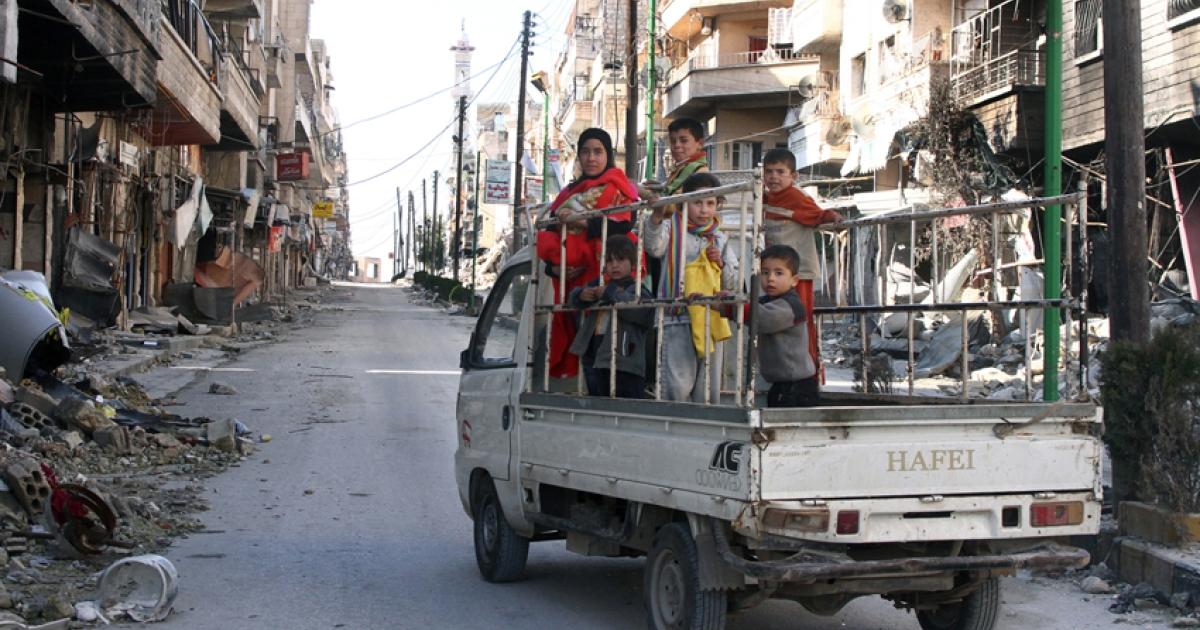 A family flee Maarat al Numan in January 2013.</p>