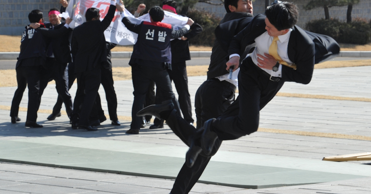 South Korean presidential body guards show martial art skills during an anti-terror drill at the president's residence on February 27, 2012, showcasing security preparations for an upcoming nuclear summit in Seoul. More recently, the country has been accused of using a Cold War-era law to arrest political opponents.</p>
