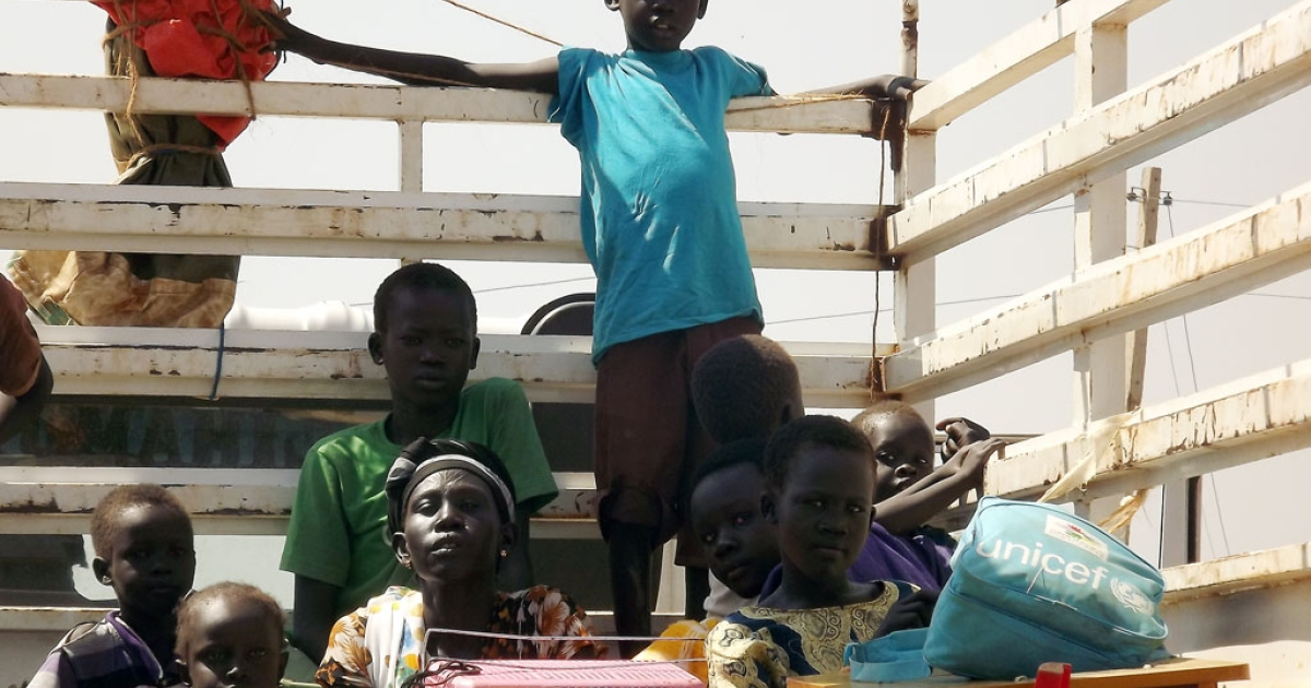 South Sudanese citizens from the Jonglei State in Juba on Jan. 4, 2014 as they try to leave for Uganda.</p>