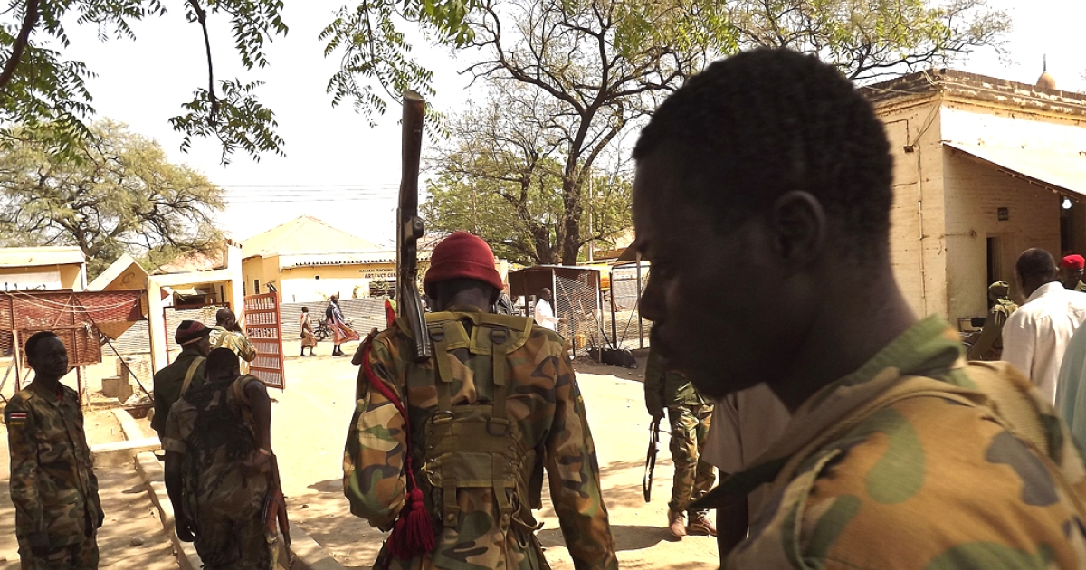 Soldiers from South Sudan's army patrol the streets of Malakal in the Upper Nile State of South Sudan on December 31, 2013. South Sudan's warring parties are set to begin peace talks in Addis Ababa aimed at bringing an end to a nearly three-week-old civil war that has already left thousands dead.</p>