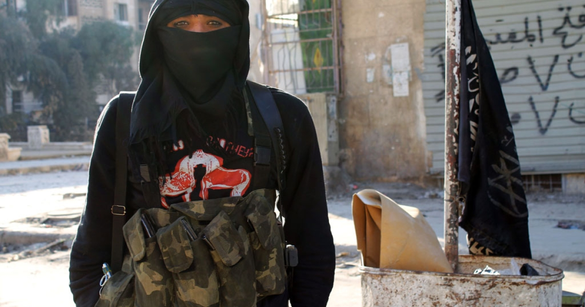 A member of the Al-Nusra Front jihadist group stands in the northern Syrian city of Aleppo on January 11, 2014. Fighting pitting the Islamic State of Iraq and the Levant (ISIL) against other rebel groups, including the Al-Nusra Front, which is also linked to Al-Qaeda but is seen as more moderate, broke out in Syria last week.</p>