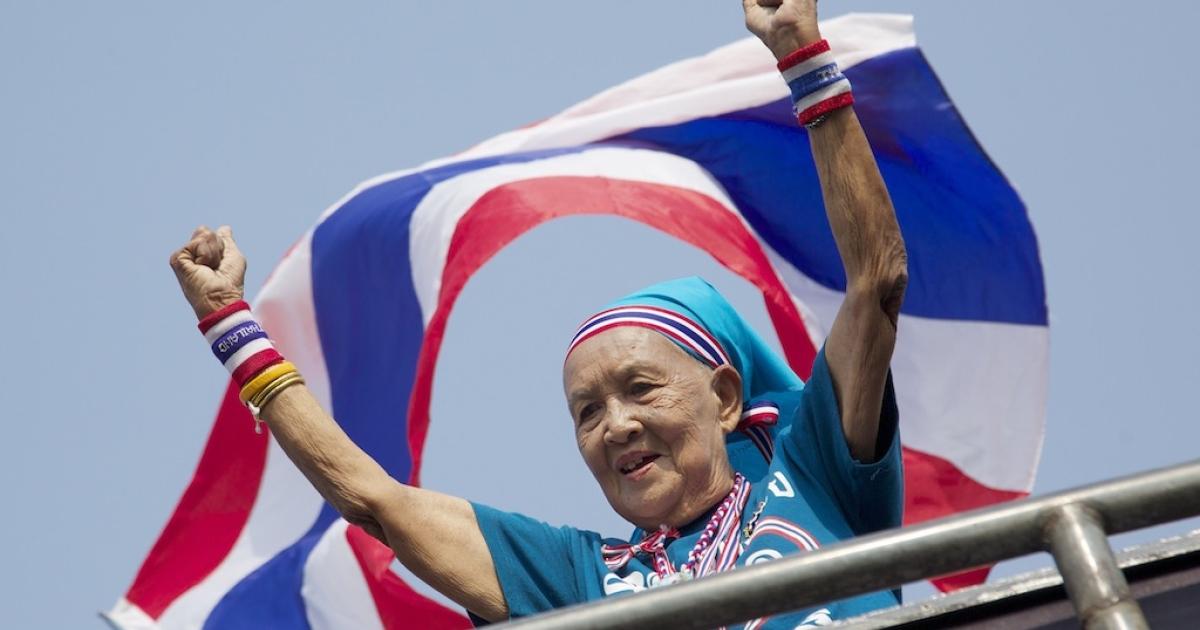 A Thai woman cheers during an anti-government march through Bangkok, Thailand on Jan. 20, 2014.</p>
