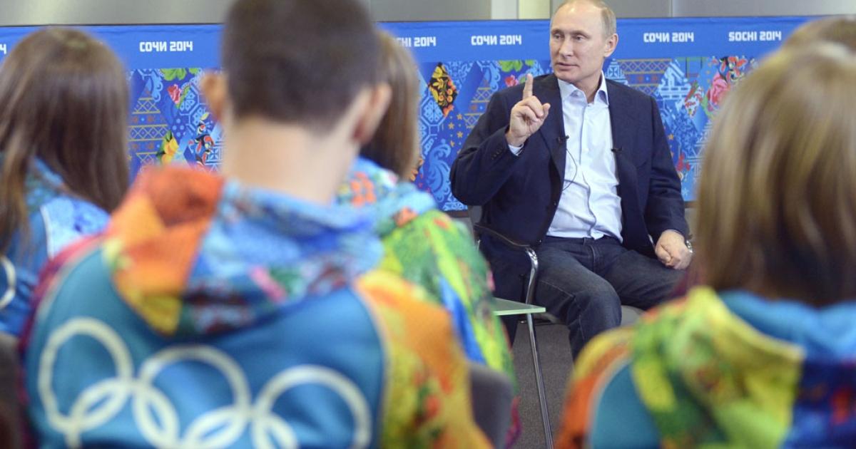 Russian President Vladimir Putin meets Olympic volunteers in Sochi on January 17, 2014.</p>