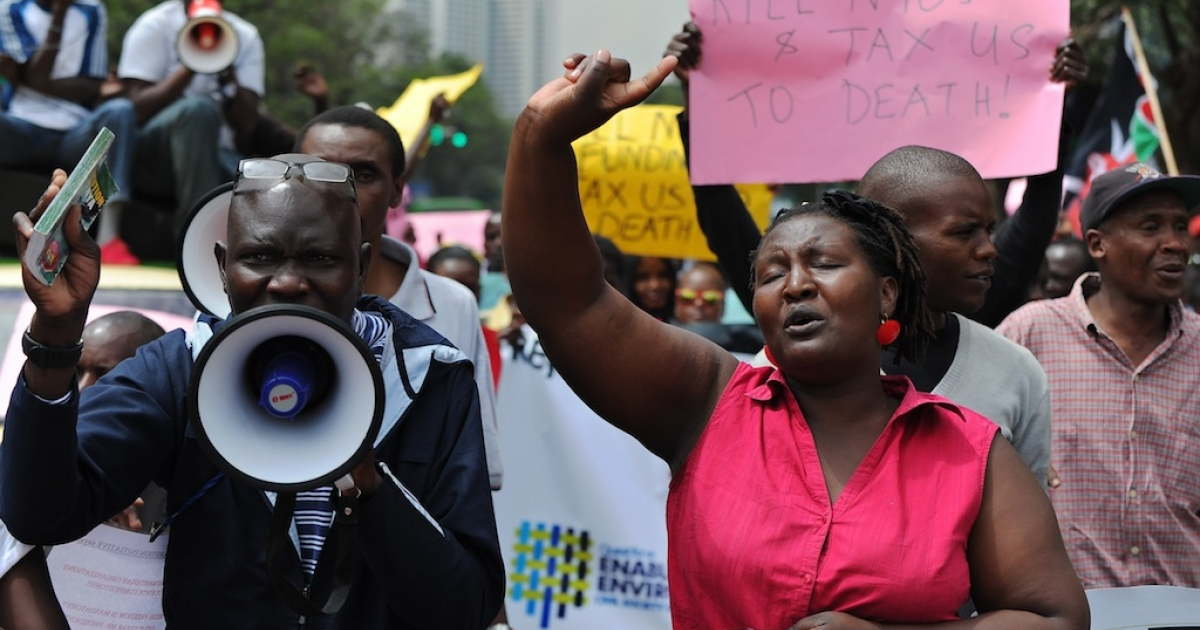 Civil activists demonstrate on November 21, 2013 in Nairobi, Kenya outside parliament over two bills they say curb hard-won freedoms, muzzle government critics and undermine democracy.</p>