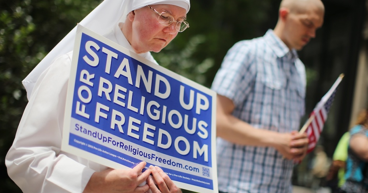 Sister Caroline (L) attends a rally with other supporters of religious freedom to praise the Supreme Court's decision in the Hobby Lobby, contraception coverage requirement case on June 30, 2014 in Chicago, Illinois. Oklahoma-based Hobby Lobby, which operates a chain of arts-and-craft stores, challenged the provision and the high court ruled 5-4 that requiring family-owned corporations to pay for insurance coverage for contraception under the Affordable Care Act violated a federal law protecting religious freedom.</p>