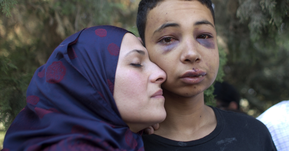 Tariq Abu Khdeir, a Palestinian-US teenager who was allegedly beaten during police custody, is hugged by his mother following a hearing at Jerusalem Magistrates Court.</p>