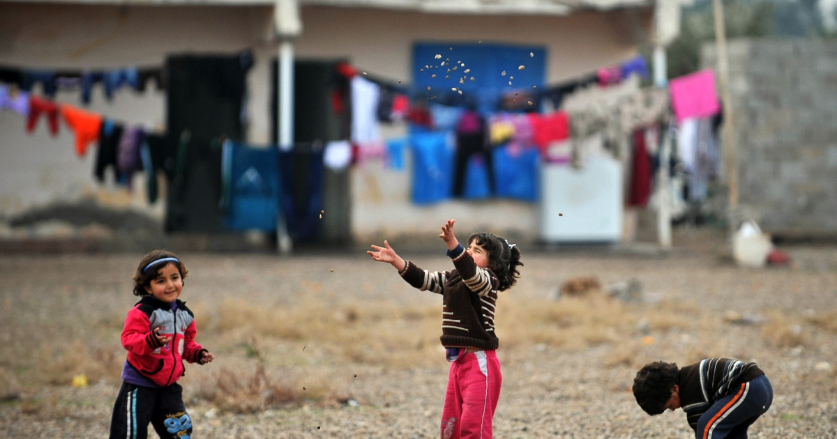 Syrian children play in a refugee camp in Reyhanli.</p>
