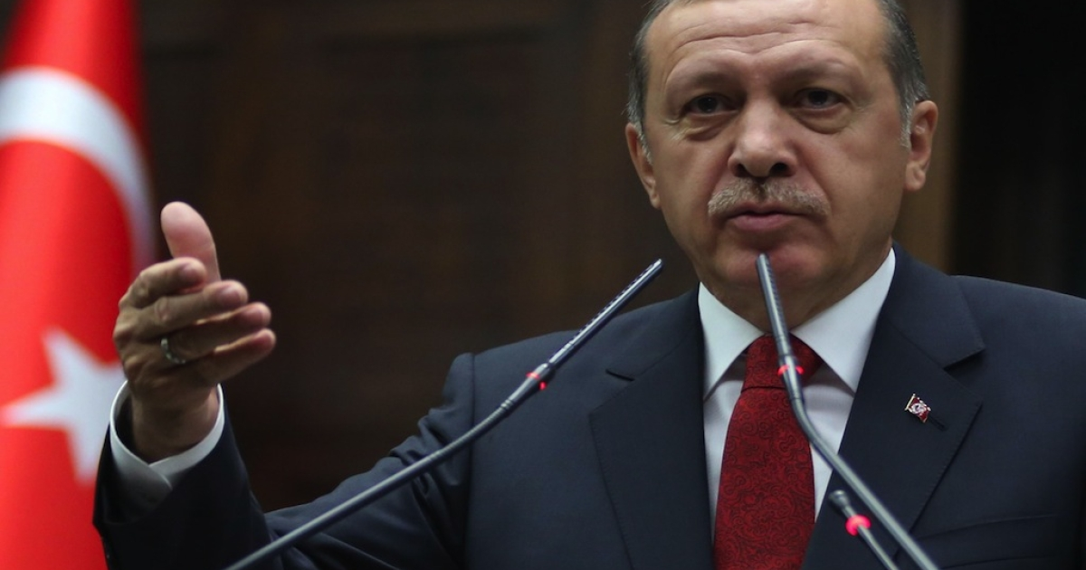 Turkey's Prime Minister Recep Tayyip Erdogan speaks during the parliamentary group meeting of Turkey's ruling Justice and Development Party in the Grand National Assembly of Turkey (TBMM) on May 13, 2014 in Ankara.</p>