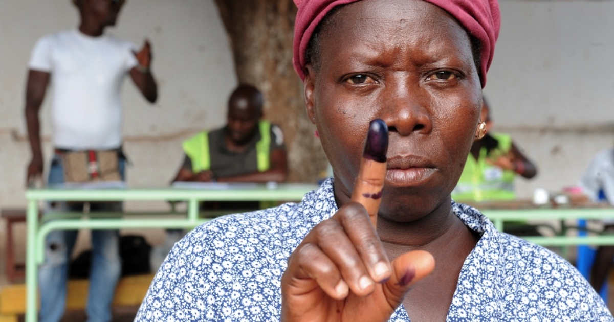 A woman raises her ink-stained finger after voting in the second round of the presidential election on May 18, 2014 in Bissau. Guinea-Bissau voted for a new president on May 18 in a key test for a fragile state plagued by powerful cocaine cartels and upended in a military coup two years ago.</p>