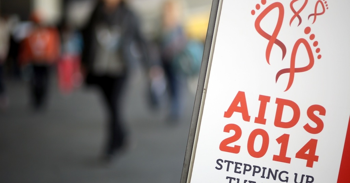 Conference attendees arrive at the 20th International AIDS Conference at The Melbourne Convention and Exhibition Centre on July 20, 2014 in Melbourne, Australia. Around 12,000 experts, activists, and policymakers from all over the world attended the event.</p>