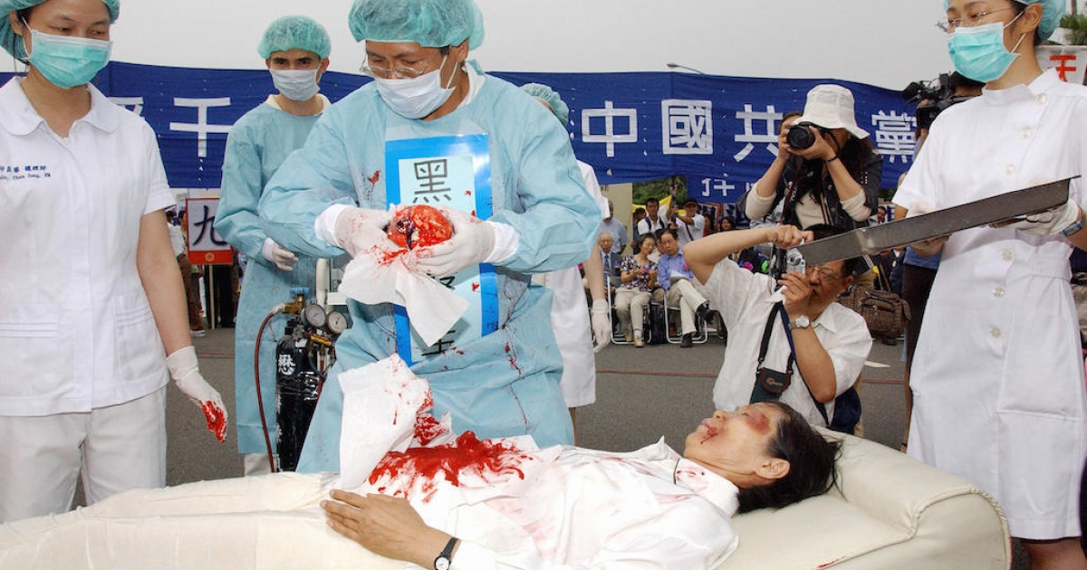During a Falun Gong rally in Taiwan in 2006, four demonstrators play in an action drama against what they said was the Chinese communists' killing of Falun Gong followers and harvesting of their organs in concentration camps. China recently placed the outlawed group at the top of its list of terrorist organizations, despite no history of violence against others.</p>