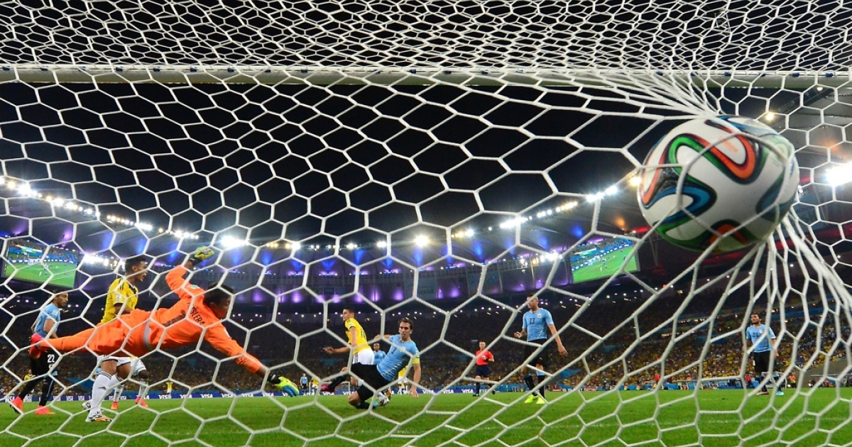 Uruguay's goalkeeper Fernando Muslera fails to stop Colombia's midfielder James Rodriguez's goal at the Maracana Stadium in Rio de Janeiro during the 2014 FIFA World Cup in Brazil on June 28.</p>