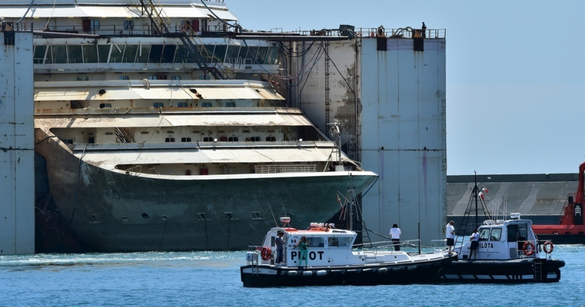 The refloated wreck of the Costa Concordia cruise liner is towed to the Italian port of Genoa on July 27, 2014.</p>