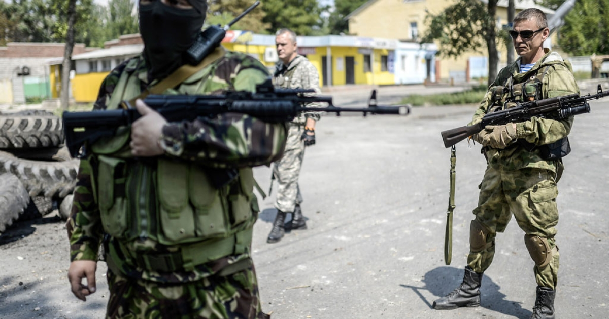 Pro-Russia separatists stand at their checkpoint near the frontline in the northern outskirts of Donetsk in Ukraine, on July 22, 2014.</p>