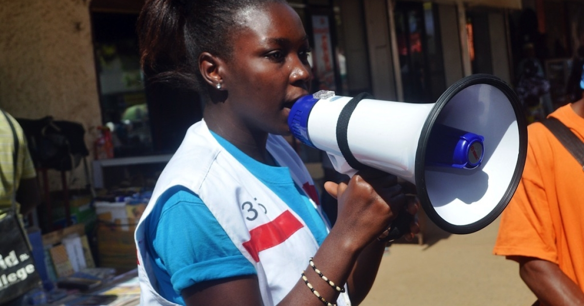 A member of the Guinean Red Cross uses a megaphone to give information concerning the Ebola virus during an awareness campaign on April 11, 2014 in Conakry. Guinea has been hit by the most severe strain of the virus, known as Zaire Ebola, which has had a fatality rate of up to 90 percent in past outbreaks, and for which there is no vaccine, cure or even specific treatment.</p>