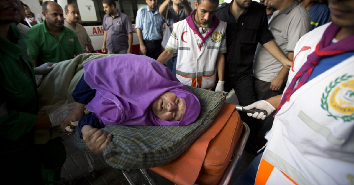 A Palestinian woman wounded in an Israeli air strike in Gaza City is taken to the hospital on July 11, 2014.</p>