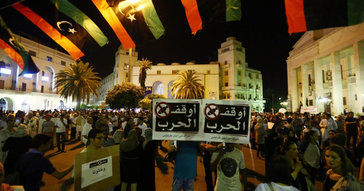 Libyans condemn and urge for an end of war during a protest at the Algeria Square July 26, 2014 in Tripoli, Libya.</p>
