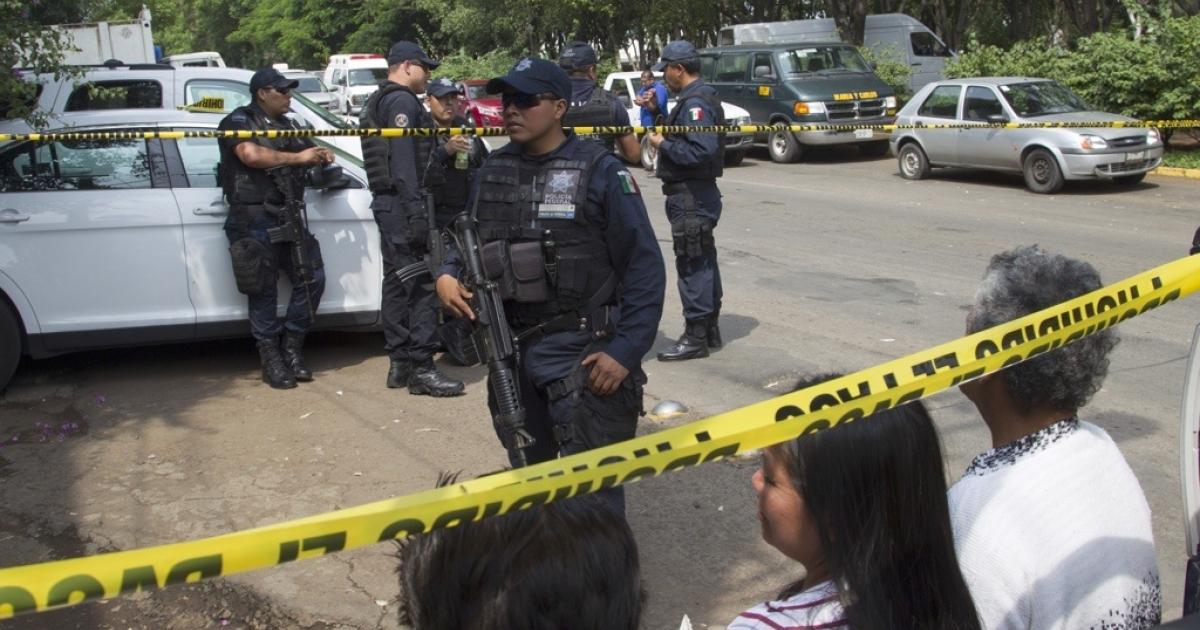 Relatives of children await outside the shelter