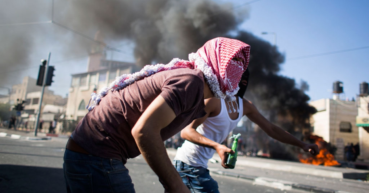 Palestinian youth clash with Israeli police near the house of murdered Palestinian teenager Mohammed Abu Khudair on July 2, 2014 in Jerusalem, Israel.</p>