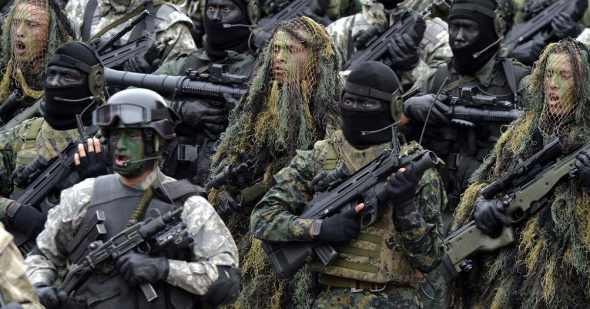 Peruvian army special forces march during a traditional military parade in Lima.</p>