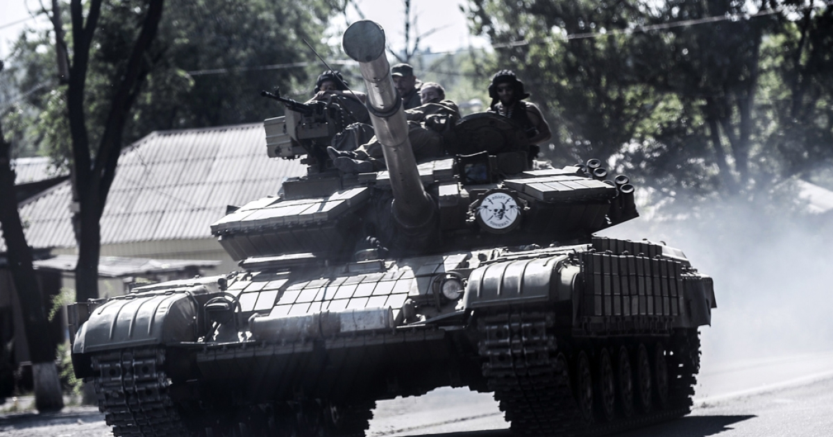 Pro-Russian militants sit on a tank on July 27, 2014 in Donetsk, eastern Ukraine.</p>
