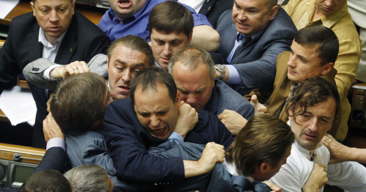 Deputies of the majority fight with the deputies of Regions Party, party of former Ukrainian President Viktor Yanukovych, during the debates in the parliament in Kiev on July 22, 2014. The parliament adopted the presidential decree on partial mobilization. AFP PHOTO/ STR        (Photo credit should read STR/AFP/Getty Images)</p>