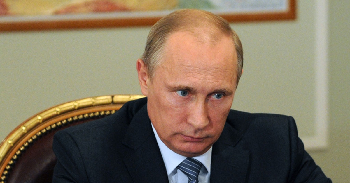 Russia's President Vladimir Putin attends a meeting in his Novo-Ogaryovo residence outside Moscow, on July 29, 2014.</p>