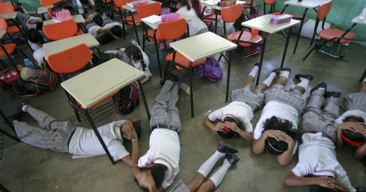Elementary school students practice a simulated shooting drill in Acapulco in 2010. Mexican authorities believe the carnage of the drug war is pushing more kids toward violence.</p>