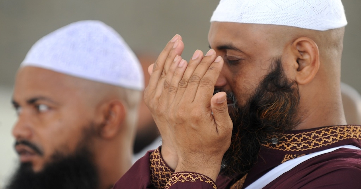 Muslim pilgrims pray to God after they threw pebbles at pillars during the 2nd day of