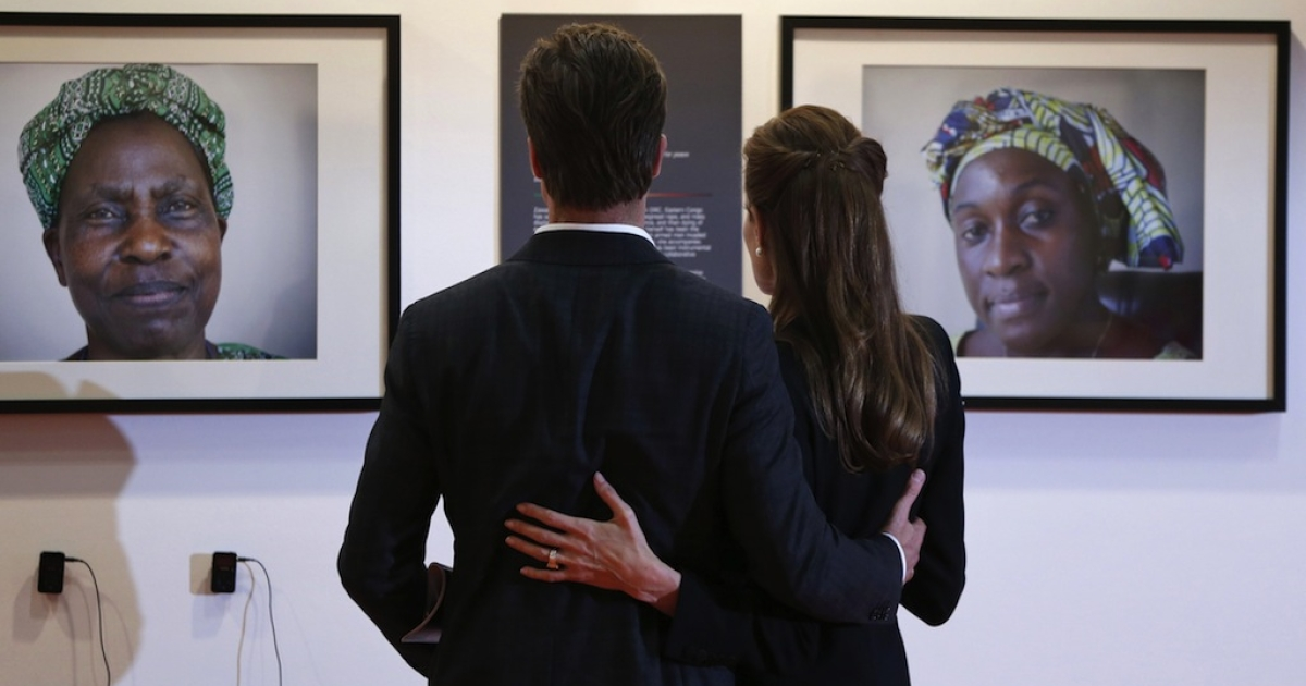 US actress Angelina Jolie, Special Envoy for the United Nations High Commissioner for Refugees, and her partner US actor Brad Pitt, look at displayed pictures of victims of violence during the third day of the Global Summit to End Sexual Violence in Conflict in London on June 12, 2014. Pitt added his A-list support to his partner Angelina Jolie's efforts to eradicate rape in war zones when he joined her in a flashbulb-popping appearance at a global conference in London.</p>