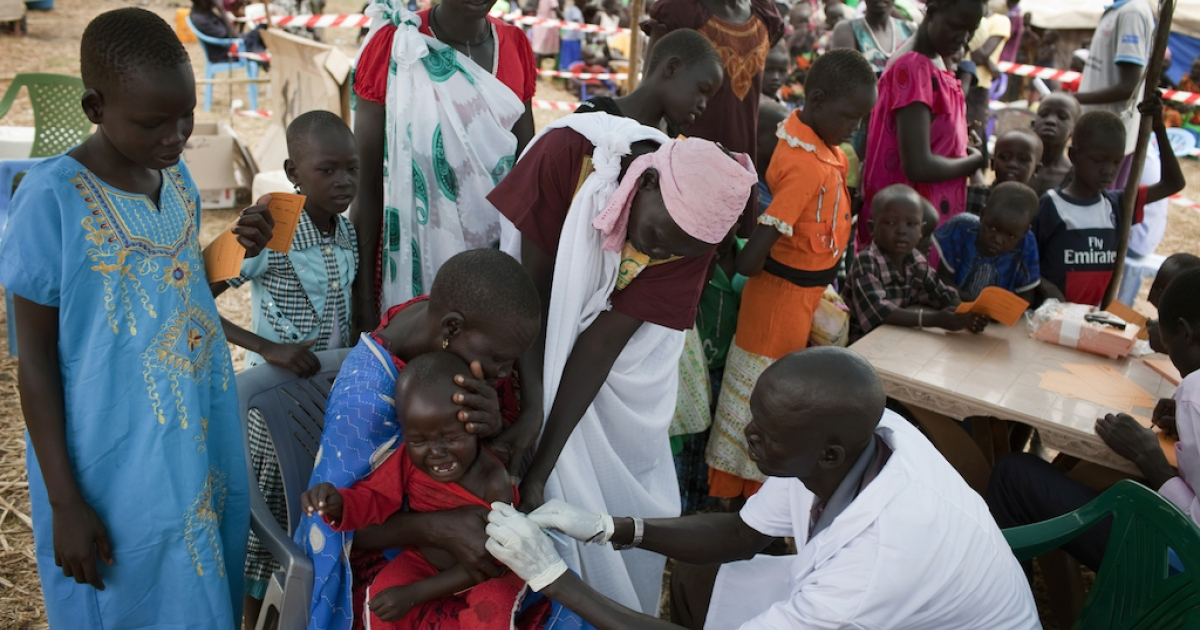 A South Sudanese child receives measles vaccination given by Medecins Sans Frontieres (MSF, Doctors without Borders) in an isolated makeshift IDP camp for Dinka ethnic group placed in an island betweet Bor and Minkamman on March 5, 2014.</p>