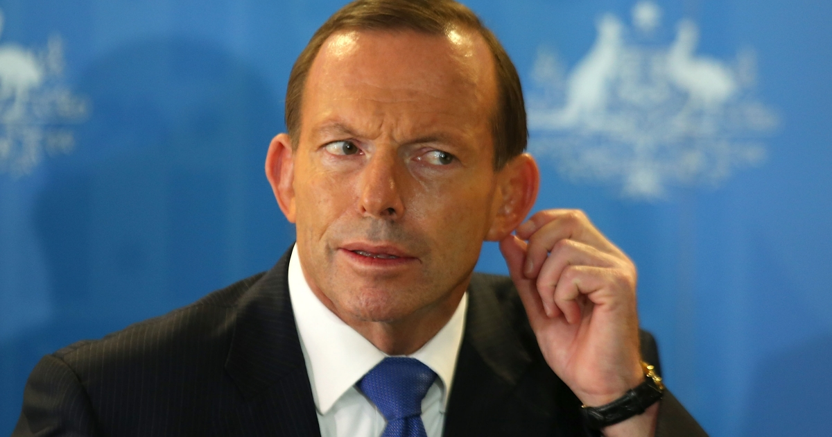 Australian Prime Minister Tony Abbott listens to a question from a reporter during a press conference at RAAF base Pearce on March 31, 2014 in Perth, Australia.</p>
