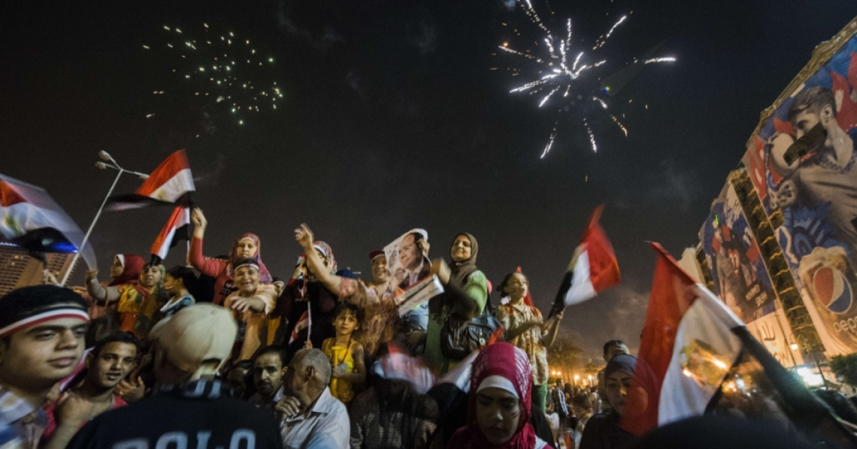 Supporters of the new President Sisi celebrate in Cairo on June 3, 2014. After his inauguration less than a week later, seven men were arrested for sexually assaulting women during similar celebrations.</p>
