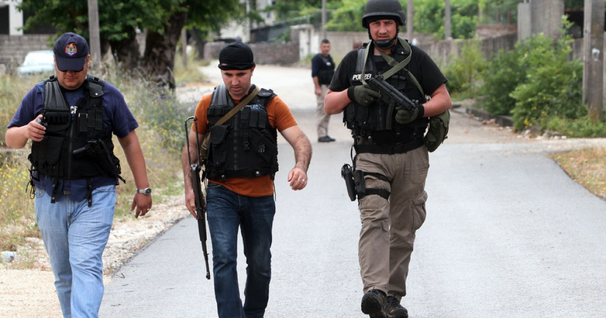 Albanian police officers leave the town of Dervican near Lazarat, a village known as Europe's cannabis capital, south of the Albanian capital Tirana, on June 17, 2014.</p>