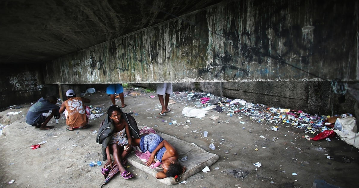 Drug users gather beneath an overpass in an area known as 'Cracolandia', or Crackland, in the Antares favela, in Rio de Janeiro, Brazil.</p>
