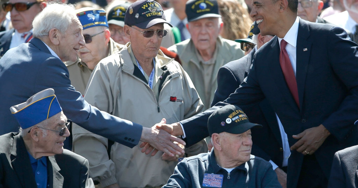 US President Barack Obama greets World War II veterans during a ceremony at the Normandy American Cemetery on the 70th anniversary of D-Day June 6, 2014 in Colleville-sur-Mer, France.</p>