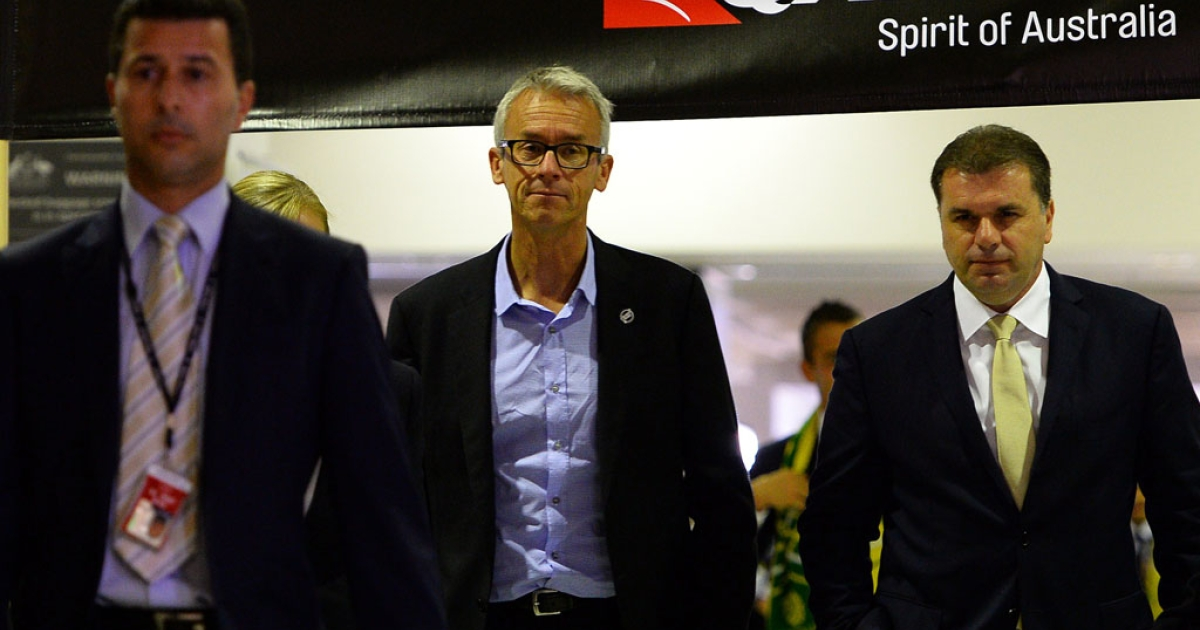 Football Federation Australia chief executive David Gallop and Australian national football team's head coach Ange Postecoglou depart with the World Cup 2014 squad for Brazil on May 28, 2014.</p>