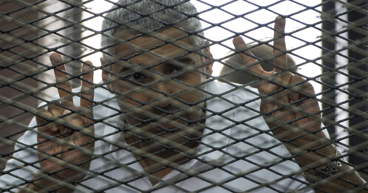 Al-Jazeera's Egyptian-Canadian Mohamed Fadel Fahmy at his trial for allegedly supporting the Muslim Brotherhood, June 23, 2014.</p>