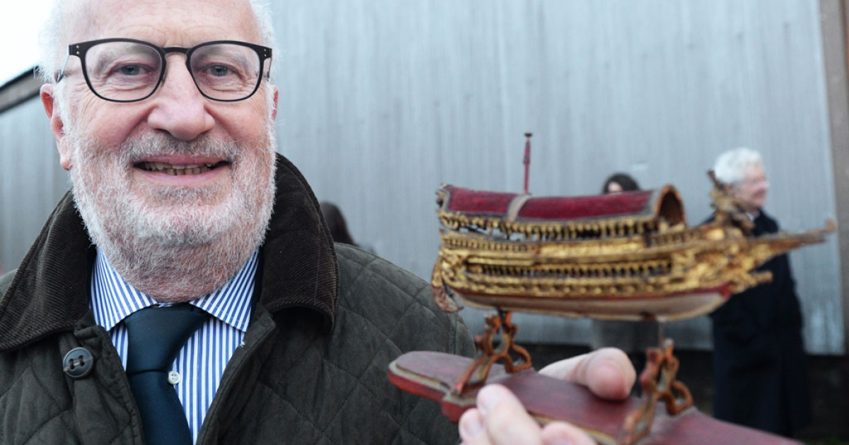 Mayor of Venice Giorgio Orsoni poses with an original 18th century replica of the Bucintoro vessel in France on Feb. 15, 2014.</p>