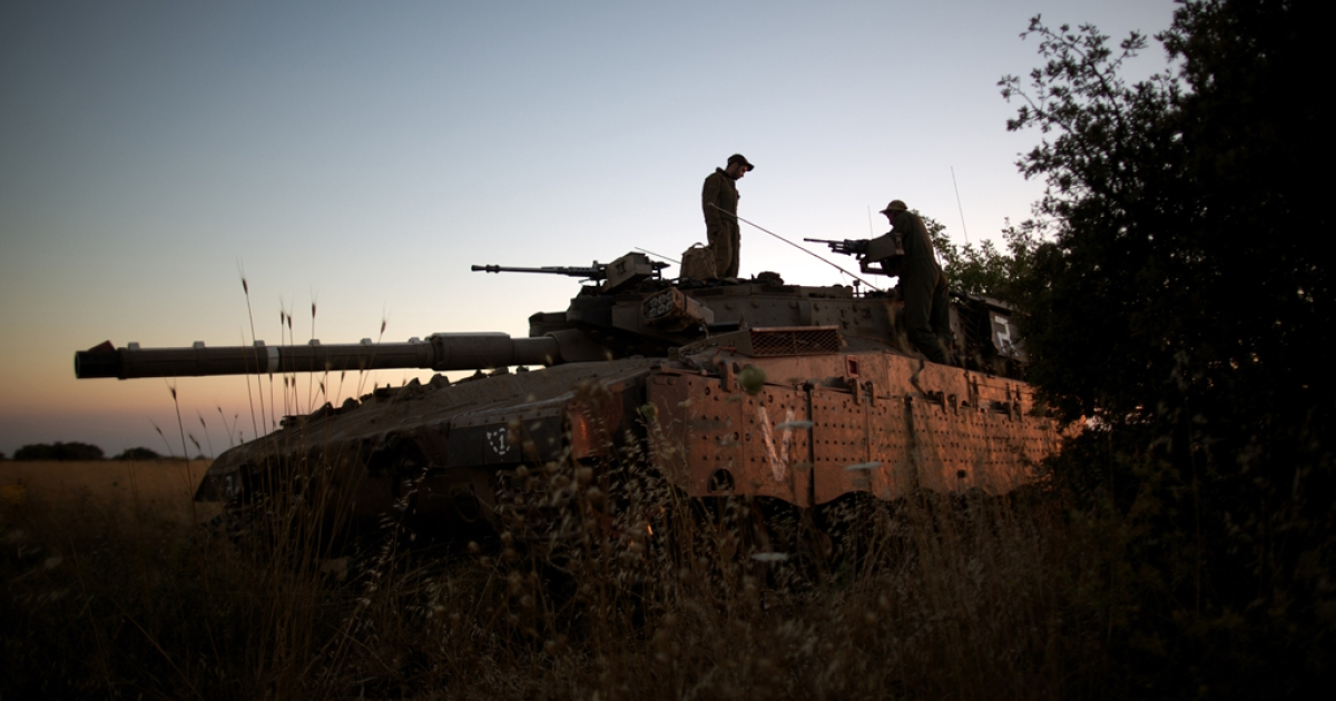 Israeli soldiers positioned near the Quneitra checkpoint on the border with Syria in the Golan Heights, June 22, 2014.</p>