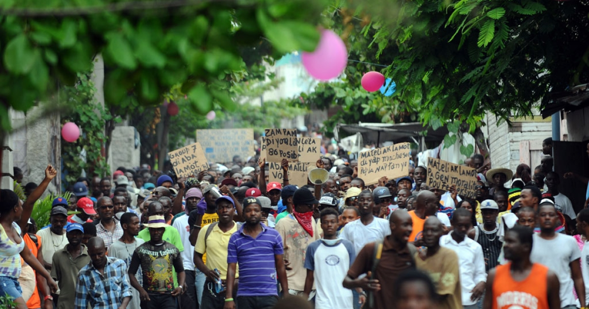 Demonstrators march during an anti-government protest in Port-au-Prince on June 5, 2014.</p>